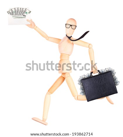 wooden Dummy with case and envelope full of money Isolated on a white backgrond - stock photo