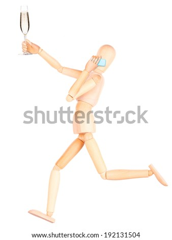 wooden Dummy with champagne talking on mobile phone Isolated on a white backgrond