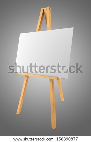 wooden easel with blank canvas isolated on gray background