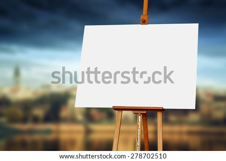 Wooden easel with blank painting canvas as copy space for mock up paintwork - stock photo