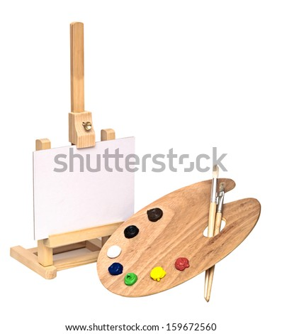 Wooden easel with clean paper and wooden artists palette loaded with various color paints and brush, isolated on a white background - stock photo