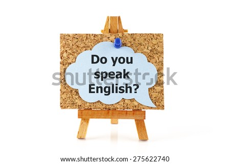 Wooden easel with corkboard and blue speech bubble with words Do you speak English? isolated on white background - stock photo