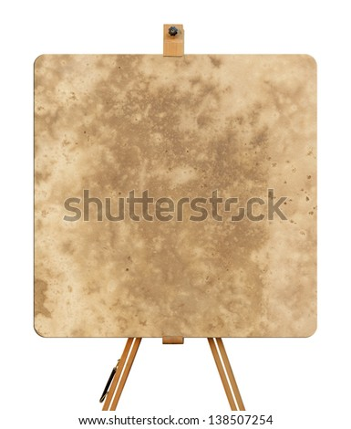 Wooden easel with vintage canvas - stock photo