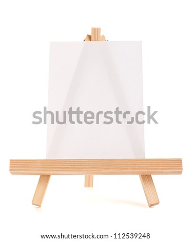 Wooden easel with white canvas