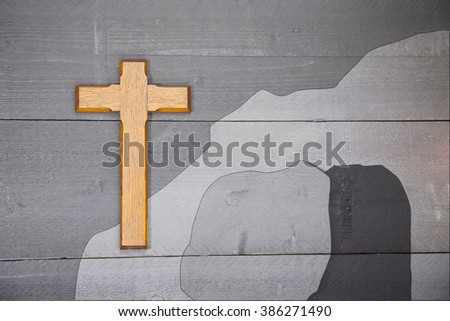 Wooden easter cross on black wooden background - stock photo