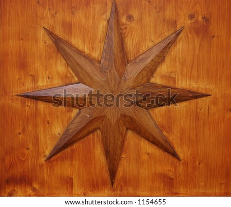 Wooden eight point star on a wooden background