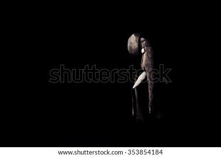 Wooden elephant statue, african figure, wood texture on black background, low key macro closeup - stock photo