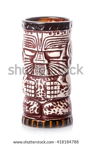 wooden empty tiki mug painted like an indian on the white background - stock photo