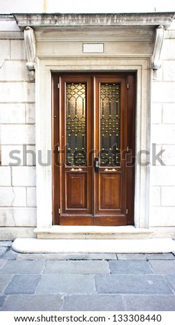 Wooden entrance door in front of residential house