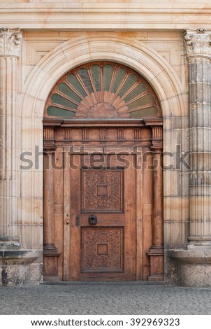 Wooden entry portal gate of old medieval house