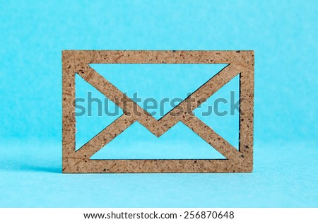 Wooden envelope icon on blue background.
