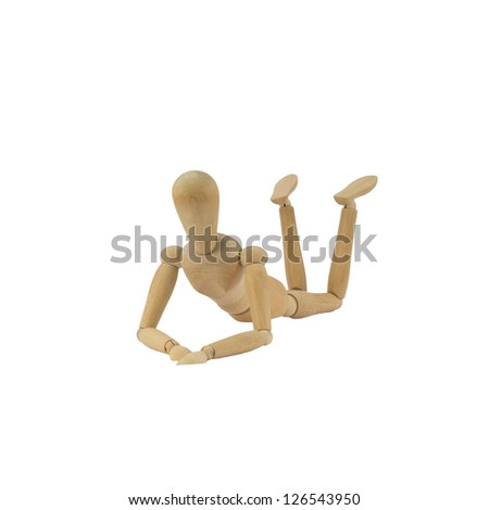 Wooden female figure is lying on her belly