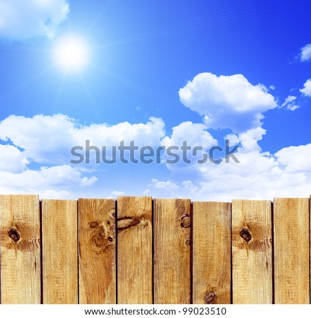 Wooden fence against the sky - stock photo