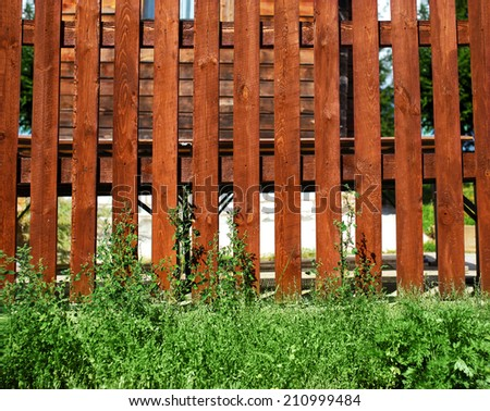 Wooden fence and grass, construction, village, gardening - background - stock photo