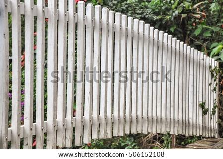 Wooden fence and tree with side view.