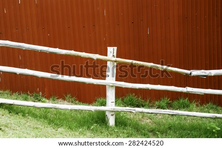 Wooden fence at farm - stock photo