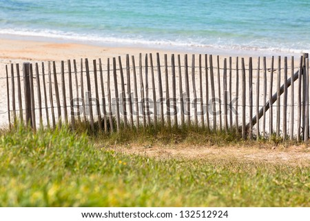 Wooden fence at Northern beach in France. Horizontal shot