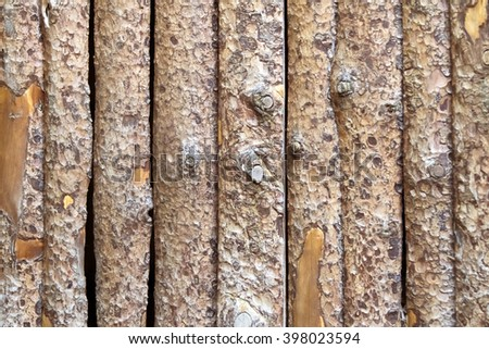 Wooden fence from untreated boards - stock photo