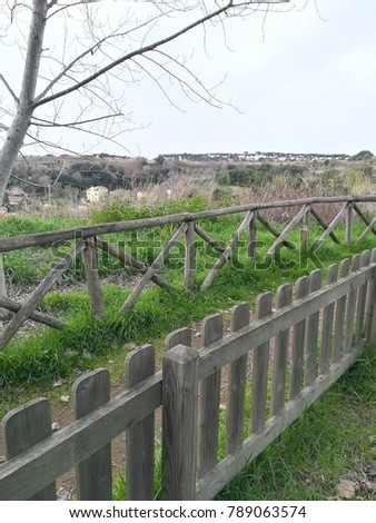 wooden fence in a meadow in perspective