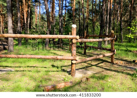 wooden fence in green forest