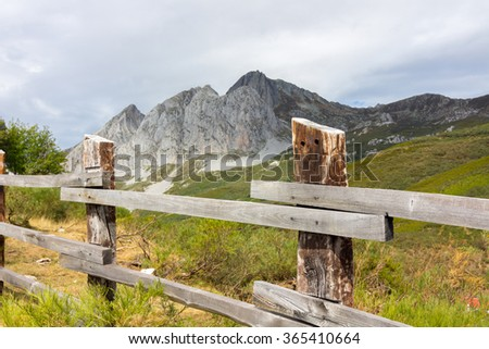 wooden fence in high mountain meadow - stock photo