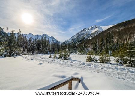 Wooden fence in winter landscape of Tatra Mountains near Morskie Oko lake, Poland - stock photo
