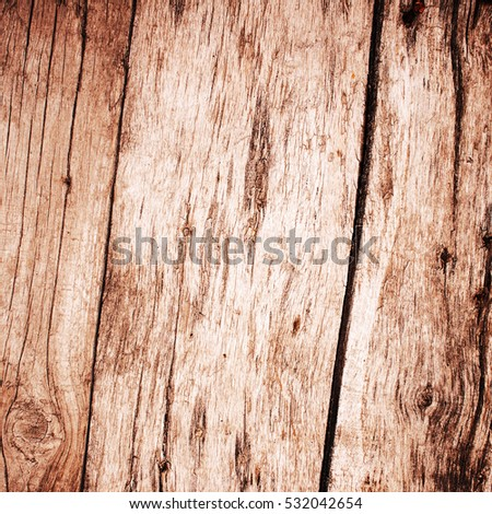 Wooden fence made of untreated planks. Textured background image.