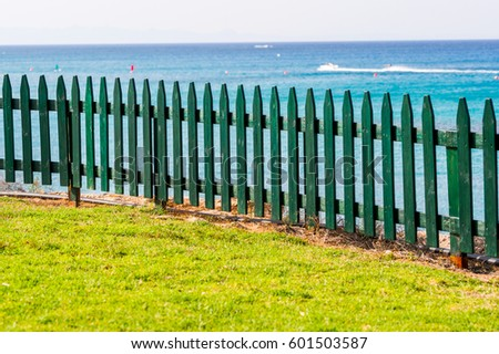 Wooden fence of green color, horizontal shot
