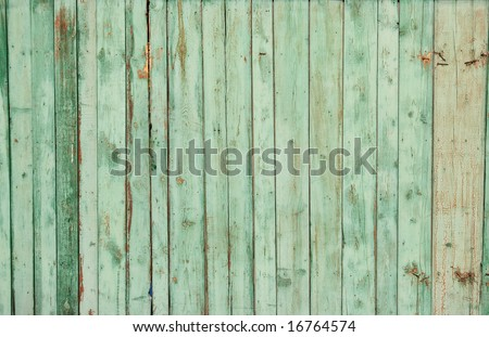 Wooden fence on all background, with traces of a paint - stock photo