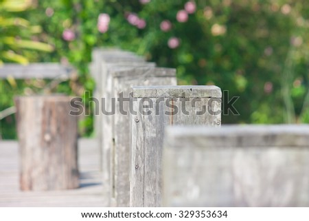 Wooden fence on rice field