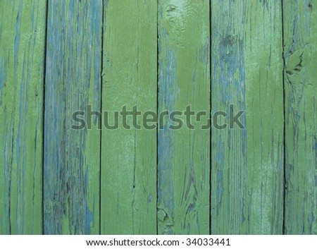 Wooden fence painted in green color - stock photo