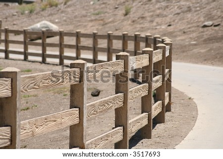 wooden fence that is curving