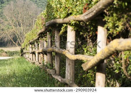 wooden fence with a fence in the countryside