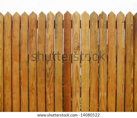 Wooden Fence -- with slats that show the natural wood pattern - stock photo