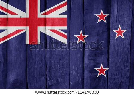 Wooden fence with the flag of New Zealand painted on it - stock photo