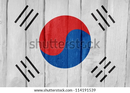 Wooden fence with the flag of South Korea painted on it