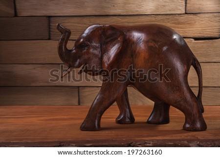 wooden figuire of elephant - stock photo