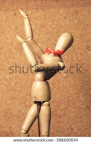 wooden figure action emotion