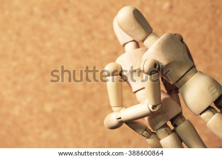 wooden figure action kiss