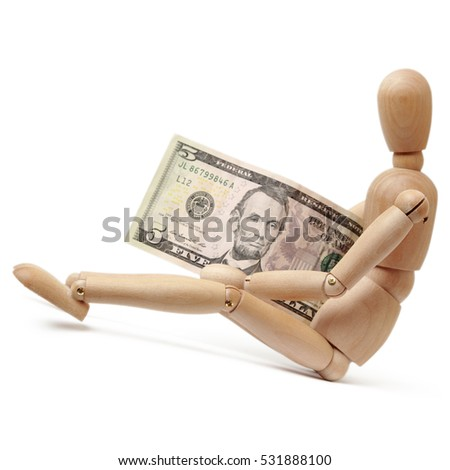 Wooden figure and dollars