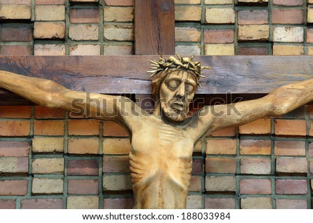 Wooden figure of Jesus crucified, in the church during Easter - stock photo