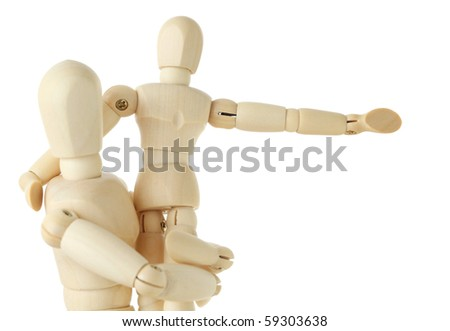 wooden figures of child sitting on hands of his parent and pointing for hand at right, half body, isolated on white