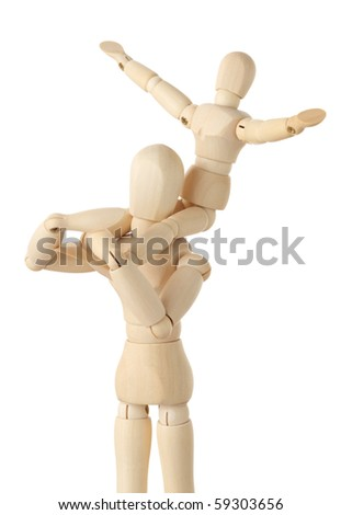 wooden figures of child sitting on neck of his parent and putting hand up, half body, isolated on white