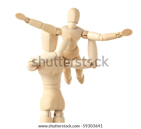 wooden figures parent holding his child on hands, half body, isolated on white