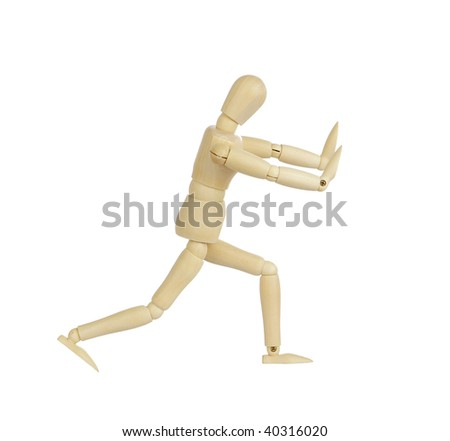 Wooden figurine in pushing position isolated on white