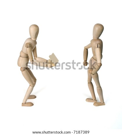 Wooden figurines against white background