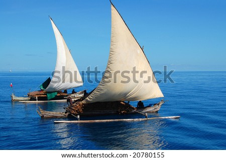Wooden Fishermen boats sailing away - stock photo