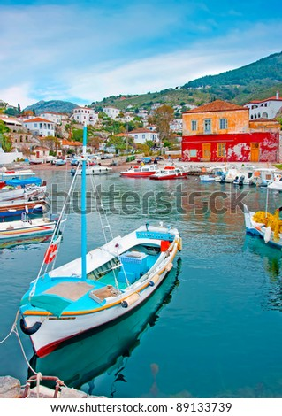 Wooden fishing boat in the beautiful small harbour Kamini of Hydra island in Saronikos gulf in Greece