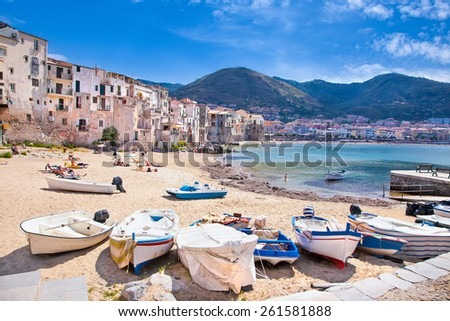 Wooden fishing boats on the old beach of Cefalu, Sicily, Italy. - stock photo