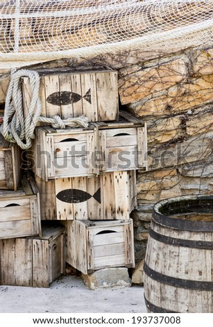 Wooden fishing crates and seine. Vertical composition.